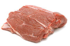 原始的牛肉部分在白色的 免版税图库摄影
