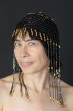 原始的盖帽的妇女 免版税库存照片
