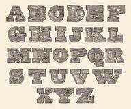 原始的被刻记的字体狂放的西部木葡萄酒 库存照片