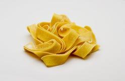 原始,长的tagliatelle意大利面食 库存图片
