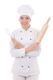 中级厨师�z�)^�W��_厨师制服的少妇有木烘烤滚针和w的 免版税库存照片