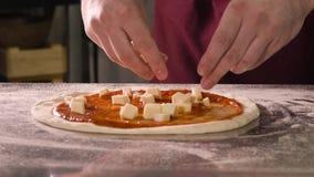 厨师在比萨投入乳酪立方体  影视素材