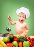 厨师帽子的男婴有烹调的平底锅和菜 库存图片