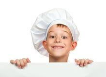 厨师男孩在空白页之后隐藏 库存照片