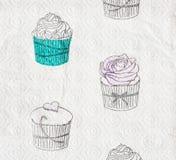 厨房与杯形蛋糕题材的毛巾纸卷 库存图片