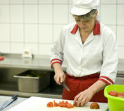 厨房妇女工作 免版税库存照片