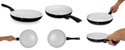 厨房煎锅以健康,不粘锅,陶瓷,举行它 免版税库存图片