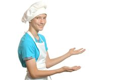 厨房男孩展示某事 库存照片