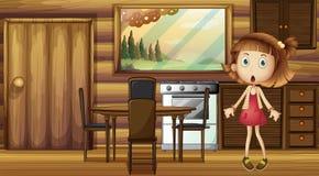 厨房的一个震惊女孩 库存照片