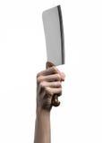厨房的题材:拿着切的厨师手肉一把大厨刀在白色背景被隔绝 库存图片