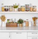 厨房长凳搁置与在白色背景的各种各样的食品成分 免版税图库摄影