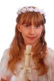 去圣餐第一个的女孩圣洁 库存图片