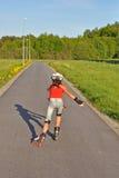 去女孩滑冰的年轻人 图库摄影