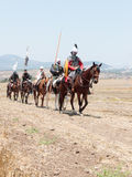参加者在Hattin垫铁的重建在1187作战在马背上留下阵营并且去争斗站点在TIb附近 库存照片