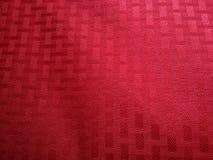 参差不齐的红色被仿造的背景 免版税库存图片