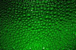 参差不齐的表面绿色背景 库存图片