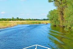 参观的多瑙河三角洲乘小船 免版税图库摄影