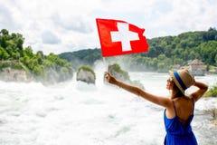 参观莱茵河瀑布的妇女在瑞士 图库摄影