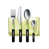 叉子、刀子和匙子在绿色餐巾 库存照片