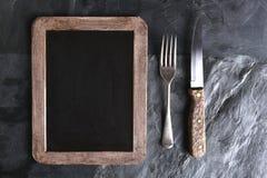 叉子刀子菜单板 库存照片
