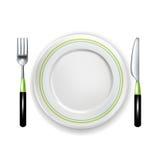 叉子和刀子有在白色隔绝的板材的 库存照片