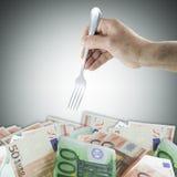叉子和货币 免版税图库摄影