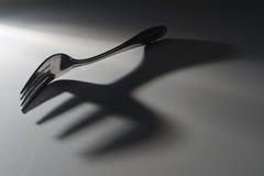 叉子影子 免版税库存图片