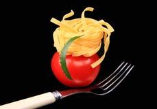 叉子意大利面食蕃茄 库存照片