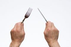 叉子递刀子 免版税图库摄影