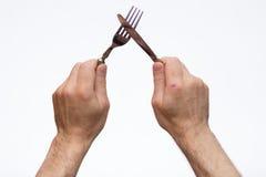 叉子递刀子 免版税库存照片