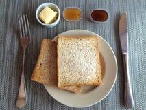 双敬酒了面包早餐 图库摄影