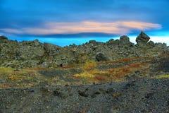 双突透镜的云彩看法在火山的风景的在Myvatn附近 免版税图库摄影