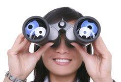 双筒望远镜女商人 免版税图库摄影