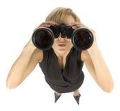 双筒望远镜女实业家 免版税库存照片