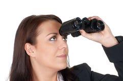 双筒望远镜女实业家 免版税库存图片