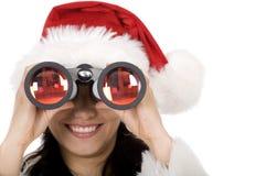 双筒望远镜女性圣诞老人 免版税库存照片
