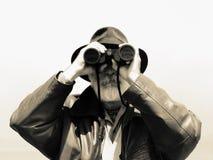 双筒望远镜探险家人 库存照片