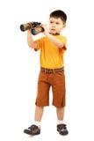 双筒望远镜男孩查找的一点 免版税库存图片