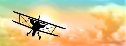 双翼飞机剪影有云彩的 库存例证