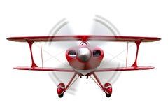 双翼飞机飞行查出的红色 免版税库存图片