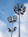 双聚光灯杆有蓝天背景 库存图片