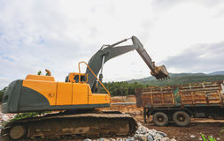 反向铲或挖掘机 免版税库存照片