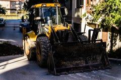 反向铲装载者在四德街 图库摄影