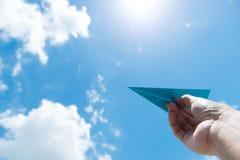 反对多云天空的纸飞机 免版税图库摄影