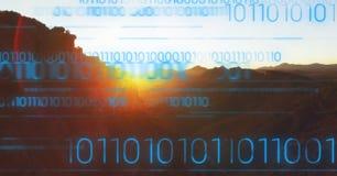 反对山和日落的蓝色二进制编码 免版税库存照片