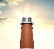 反对日出背景的一座灯塔  库存照片