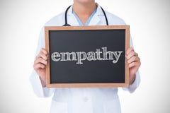 反对显示一点黑板的医生的同情 图库摄影