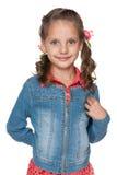 反对白色的可爱的小女孩 免版税库存图片