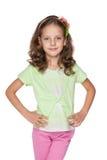 反对白色的小女孩 免版税图库摄影