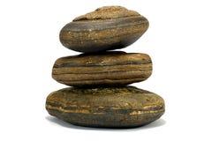 反对白色背景的布朗平衡的石头 免版税库存照片